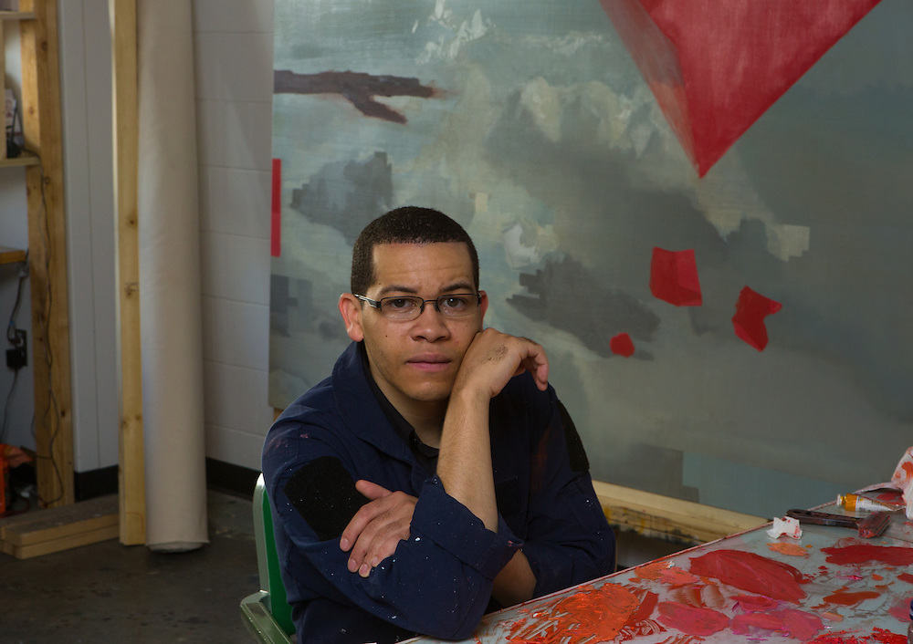"Painter Leslie Smith III in his studio in front  of a recent painting titled ""Sticks, Stone and Drones."""