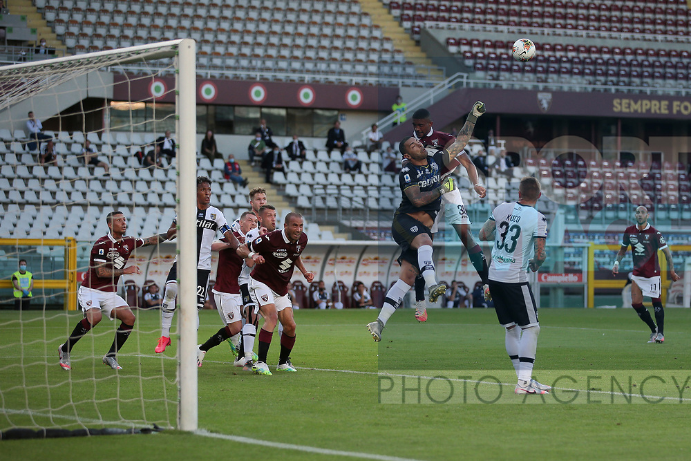 Parma Calcio's Italian goalkeeper Luigi Sepe punches clear from Torino FC's Brazilian defender Gleison Bremer during the Serie A match at Stadio Grande Torino, Turin. Picture date: 20th June 2020. Picture credit should read: Jonathan Moscrop/Sportimage