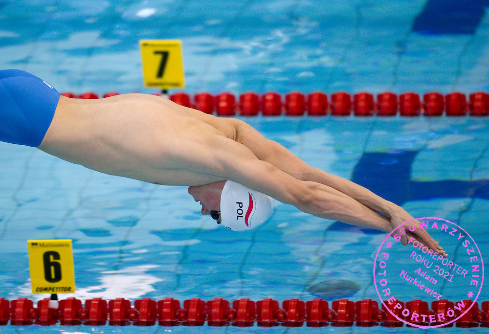 Mateusz Slawinski of Poland competes in Men's 100m Freestyle qualification heat during European Short Course Swimming Championships Szczecin 2011 at Floating Arena in Szczecin...Poland, Szczecin, December 9, 2011..Picture also available in RAW (NEF) or TIFF format on special request...For editorial use only. Any commercial or promotional use requires permission...Photo by © Adam Nurkiewicz / Mediasport