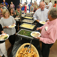 Area residents and business owners make their way through the food line prior to the start of the Daily Journal's Reader's Choice Awards Thursday night at Building V of the Tupelo Furniture Market.