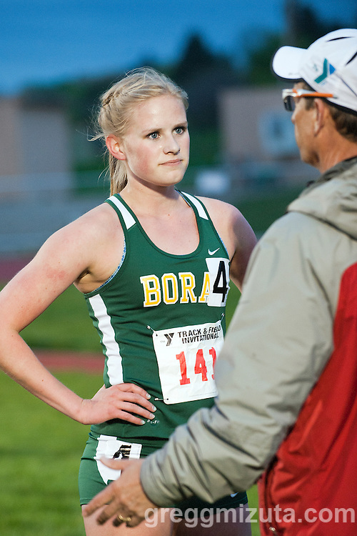 Borah sophomore Sara Christianson listens to coach Tim Severa following the YMCA Track &amp; Field Invitational 1600 meter run. Friday, April 26, 2014 at Bishop Kelly High School, Boise, Idaho.  <br /> <br /> 1. Emily Hamlin, 4:54.56, 	Boise	<br /> 2. Samantha McKinnon, 5:03.85, Mountain View (ID)<br /> 3. Erin Hagen, 5:07.41, Mountain View (ID)	<br /> 4. Sara Christianson	, 5:10.30, Borah	<br /> 5. Mikayla Malaspina, 5:12.21, Vallivue	<br /> 6. Audrey Rustad, 5:20.09, Boise	<br /> 7. Mia Klopfenstein, 5:23.00, Meridian	<br /> 8. Sierra Manzer, 5:24.67, Melba
