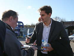 Millwall's Ed Upson who signed yesterday from Yeovil Town signs a fan's program at The Den - Photo mandatory by-line: Robin White/JMP - Tel: Mobile: 07966 386802 01/02/2014 - SPORT - FOOTBALL - The Den - Millwall - Millwall v Reading - Sky Bet Championship