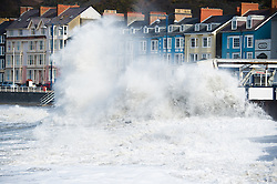 © Licensed to London News Pictures. 24/02/2015. Aberystwyth, UK  For a fourth consecutive day high 'supertides' combined with strong winds bring huge waves crashing into the sea defences and promenade at Aberystwyth on the west wales coast  UK. Photo credit : Keith Morris/LNP