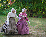 Old Bethpage, New York, USA. 30th August, 2015. L-R, identical twin sisters JULIETTE FOX of Hicksville, and PATRICIA JOSEPH of College Point, wearing Civil War era style long hoop skirt clothing, are member of the Old Bethpage Village Dancers which danced throughout the Old Time Music Weekend at Old Bethpage Village Restoration, where popular music of the American Civil War period was performed, and visitors learned traditional 1800's contradances.
