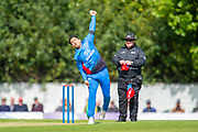 Afghan bowler Sharafuddin Ashrad bowls during the One Day International match between Scotland and Afghanistan at The Grange Cricket Club, Edinburgh, Scotland on 10 May 2019.