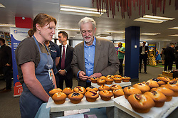 © Licensed to London News Pictures. 26/09/2015. Brighton, UK. Leader of the Labour Party JEREMY CORBYN looking at hom made cakes while visiting Entrepreneurial Spark in Brighton, a group that promotes entrepreneuring. The visit takes place on the eve of the Labour Party conference, which is being held in Brighton  Photo credit: Ben Cawthra/LNP