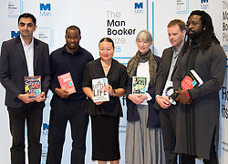 Royal Festival Hall, London, October 12th 2015. Man Booker Prize for Fiction Finalists gather at the Royal Festival Hall on the eve of the winner's announcement. PICTURED:  L-R: British writer Sunjeev Sahota, Nigerian writer Chigozie Obioma, American writer Hanya Yanagihara, American writer Anne Tyler, British Writer Tom McCarthy, Jamaican writer Marlon James