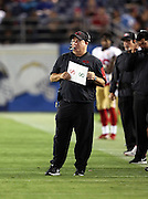 San Francisco 49ers head coach Chip Kelly looks on from the sideline while holding his play chart during the 2016 NFL preseason football game against the San Diego Chargers on Thursday, Sept. 1, 2016 in San Diego. The 49ers won the game 31-21. (©Paul Anthony Spinelli)