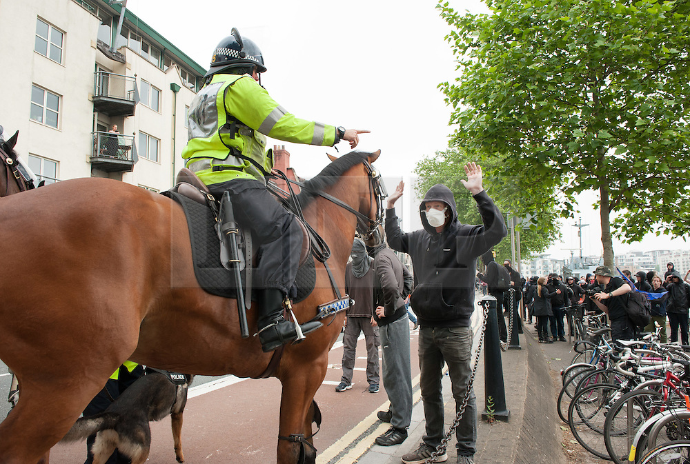 """© Licensed to London News Pictures.04/06/2016. Bristol, UK. Police and anti-fascists at protests in Bristol city  centre between the anti-immigration """"South West Infidels"""" and anti-fascist campaigners and Bristol Welcomes Refugees. There was  heavy police presence with dogs and horses, but only 18 anti-immigration protesters were escorted by police onto Bristol's College Green which was blocked off to the public by a ring of steel barriers. Photo credit: Simon Chapman/LNP"""