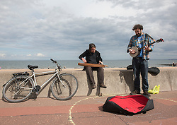 Back for the seventh year - the Portobello Big Beach Busk. Musicians of all sorts just turn up on the Prom, pick a spot from the many chalk circles drawn along the Prom and start playing! Also back for a second year is the sandcastle competition in front of the Baths. <br /> <br /> <br /> © Jon Davey/ EEm