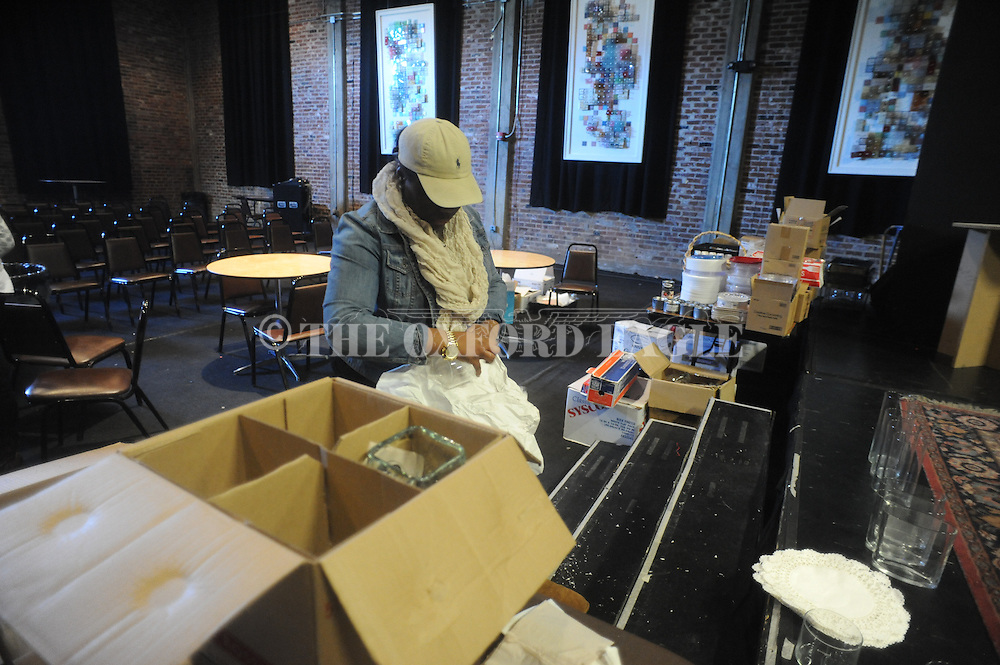 Lakrisha Curry was among volunteers who helped clean at the Powerhouse in Oxford, Miss. on Thursday, February 5, 2015.