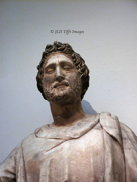 Head of Nanni di Banco's marble statue of St. Luke in the Museu dol'Opera del Duomo.  His facial expression seems to show a very condescending squint.