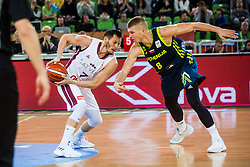 Janis Blums of Latvia and Edo Muric of Slovenia during basketball match between National teams of Slovenia and Latvia in Round #10 of FIBA Basketball World Cup 2019 European Qualifiers, on December 2, 2018 in Arena Stozice, Ljubljana, Slovenia. Photo by Grega Valancic