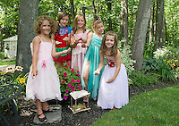 """Fairies"" from the Boys and Girls Club add sparkle to their fairy houses placed among the gardens at Robert King and Elaine Muller's home prior to Opechee Garden Club's Tour on Saturday.  (Karen Bobotas/for the Laconia Daily Sun)"