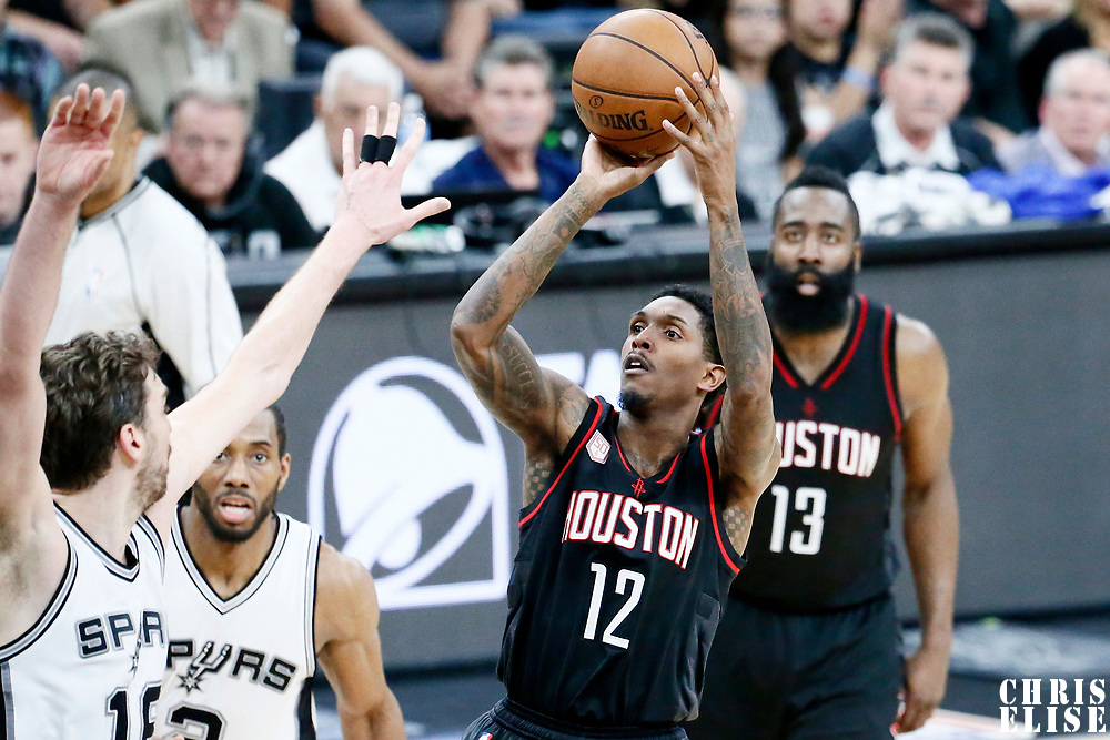 03 May 2017: Houston Rockets guard Lou Williams (12) takes a jump shot over San Antonio Spurs center Pau Gasol (16) during the San Antonio Spurs 121-96 victory over the Houston Rockets, in game 2 of the Western Conference Semi Finals, at the AT&T Center, San Antonio, Texas, USA.