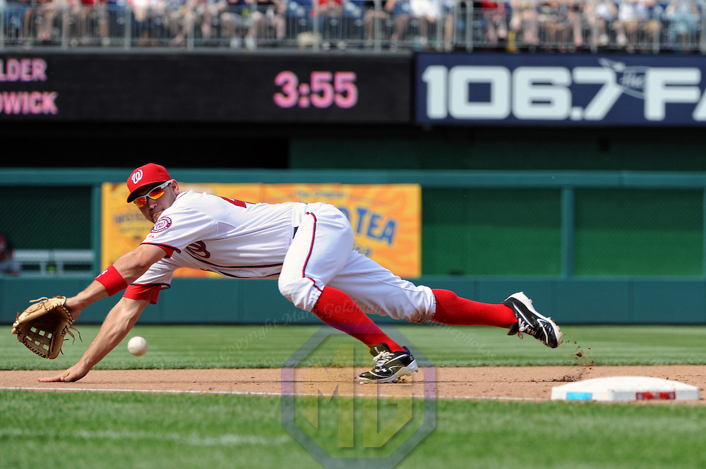 15 April 2012:  Washington Nationals third baseman Ryan Zimmerman (11) makes a diving stop against the Cincinnati Reds at Nationals Park in Washington, D.C. where the Cincinnati Reds defeated the Washington Nationals, 8-5 in eleven innings.