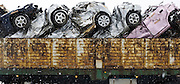 Damaged vehicles are loaded onto a truck near Minamisanriku,  Miyagi Prefecture on Feb. 25, 2012. .Photographer: Robert Gilhooly