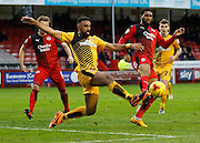 Leon Legge of Cambridge United gets a great challenge n at the near post during the Sky Bet League 2 match between Crawley Town and Cambridge United at the Checkatrade.com Stadium, Crawley, England on 9 January 2016. Photo by Andy Walter.