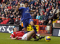 Photo: Olly Greenwood.<br />Charlton Athletic v Everton. The Barclays Premiership. 25/11/2006. Charlton's Andy Reid tackles Everton's Mikel Arteta