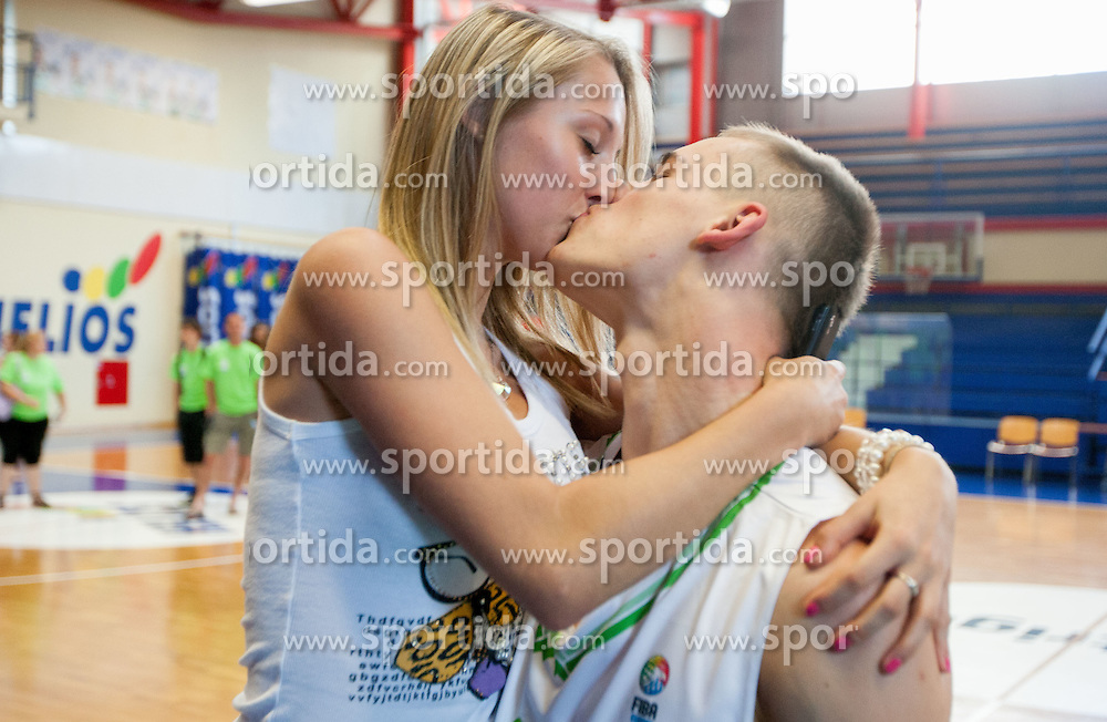 Klemen Prepelic and his girlfriend Leonela (L) during Open day of Slovenian U20 National basketball team before the European Chmpionship in Slovenia, on July 9, 2012 in Domzale, Slovenia.  (Photo by Vid Ponikvar / Sportida.com)