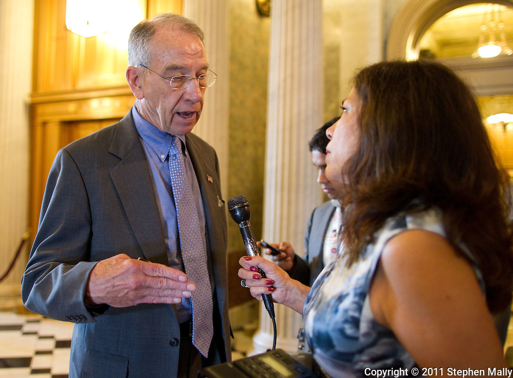 Senator Chuck Grassley (R-IA) talks with reporters outside the Senate floor before a vote in the United States Capitol building in Washington, D.C. on Thursday, June 23, 2011.