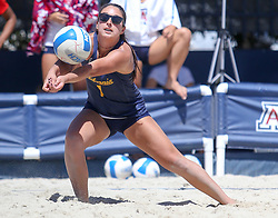 April 7, 2018 - Tucson, AZ, U.S. - TUCSON, AZ - APRIL 07: California Golden Bears Mia Merino (1) hits the ball during a college beach volleyball match between the California Golden Bears and the Arizona Wildcats on April 07, 2018, at Bear Down Beach in Tucson, AZ. Arizona defeated California 3-2. (Photo by Jacob Snow/Icon Sportswire (Credit Image: © Jacob Snow/Icon SMI via ZUMA Press)