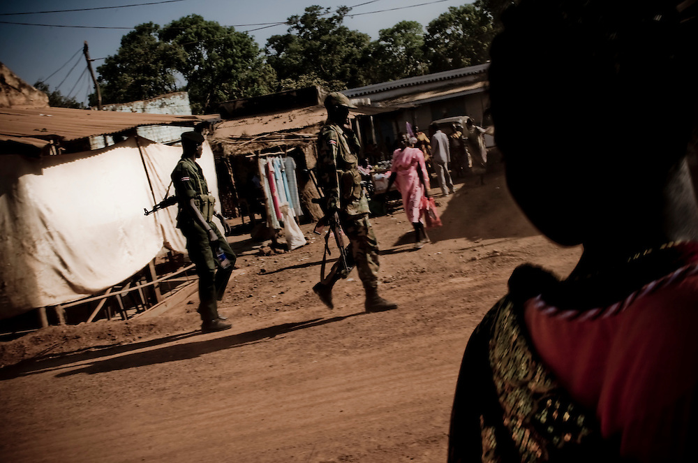 Soldiers with the SPLA patrol the morning streets in the Southern Sudanese town of Aweil. Sudan recently voted on whether or not to remain with the North or to set out alone as the world's newest nation. (© William B. Plowman)