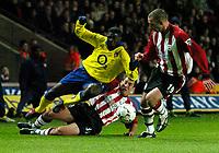 Photo: Richard Lane.<br />Southampton v Arsenal. Barclaycard Premiership.<br />29/12/2003.<br />Kolo Toure is brought down by paul Telfer as Danny Higgin bottom looks on.