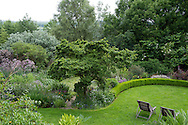 An aerial view of lawn and a wooded area in Derry Watkin's Special Plants Garden in Cold Ashton, Chippenham, Somerset, UK