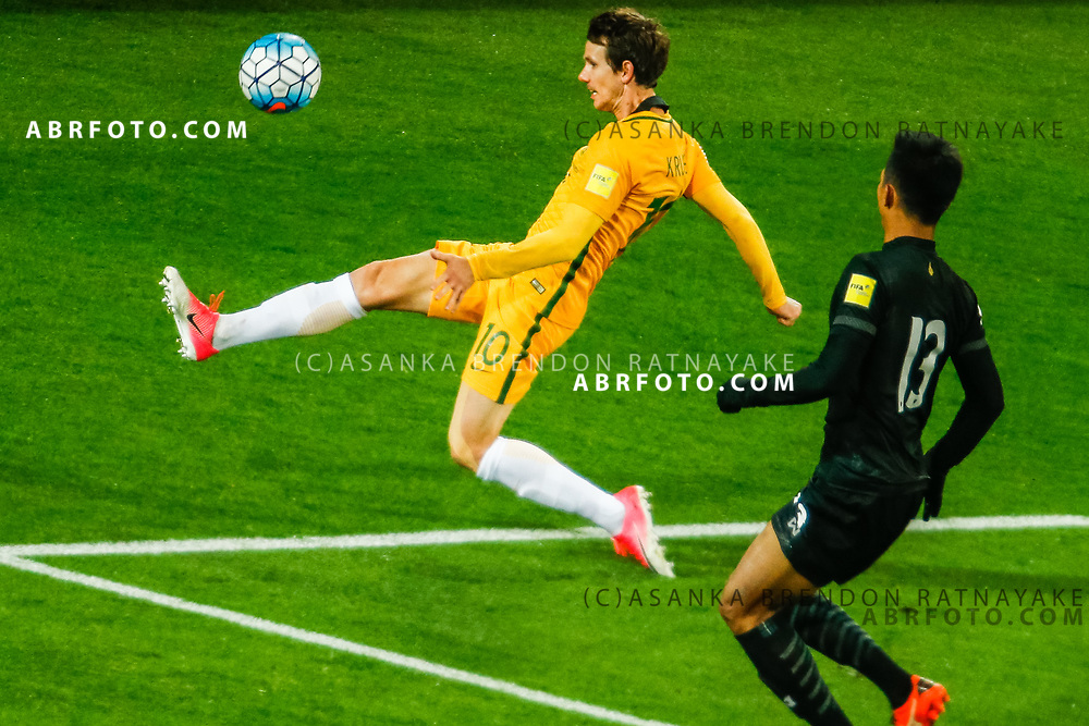 MELBOURNE, AUSTRALIA - SEPTEMBER 5 : Robbie Kruse of the Australia Socceroos keeps the ball in during the Stage 3 Group World Cup Football Qualifiers between Australia Vs Thailand at the Melbourne Rectangular Stadium, Melbourne, Australia 5 September 2017.