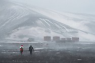 """Deception Island, Antarctica, February 2016. With a steep lava wall on one side and the notorious shallow underwater Ravn's rock on the other, it take some nerve and skill to sail through. Just around the corner of the bellows is Whalers Bay,  the remains of the """"Hector"""" Norwegian Whaling station. The place went through several periods, from the whaling, passing to be also a Navy base during the English Tabarin Operation in the Second World War, and afterwards being part of research facilities belonging to the British Antarctic Survey, formerly called Falkland Islands Dependencies.Dutch Tallship, Bark Europa, explores Antarctica during a 25 day sailing expedition. Photo by Frits Meyst / MeystPhoto.com"""