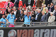 Forest Green Rovers kitman Tom Carter lifts the trophy during the Vanarama National League Play Off Final match between Tranmere Rovers and Forest Green Rovers at Wembley Stadium, London, England on 14 May 2017. Photo by Shane Healey.