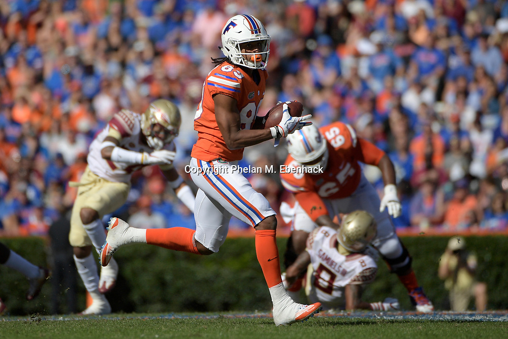 Florida wide receiver Tyrie Cleveland (89) catches a pass during the first half of an NCAA college football game against Florida State Saturday, Nov. 25, 2017, in Gainesville, Fla. (Photo by Phelan M. Ebenhack)