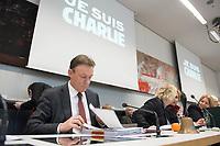 """08 JAN 2015, BERLIN/GERMANY:<br /> Thomas Oppermann, SPD Fraktionsvorsitzender, blaettert in seinen Unterlagen, vor Beginn einer Klausurtagung der SPD  Fraktion, im Hintergrund der Schriftzug """"JE SUIS CHARLIE"""" als Solidaritaetsbekundung gegenüber den am Vortag ermordeten Mitarbeitern des franzoesischen Satiere-Magazins """"Charlie Hebdo"""", Fraktionsebene, Deutscher Bundestag<br /> IMAGE: 20150108-01-007"""