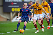 Steven Naismith (#14) of Heart of Midlothian shields the ball from Curtis Main (#9) of Motherwell FC during the Ladbrokes Scottish Premiership match between Motherwell FC and Heart of Midlothian FC at Fir Park, Stadium, Motherwell, Scotland on 17 February 2019.