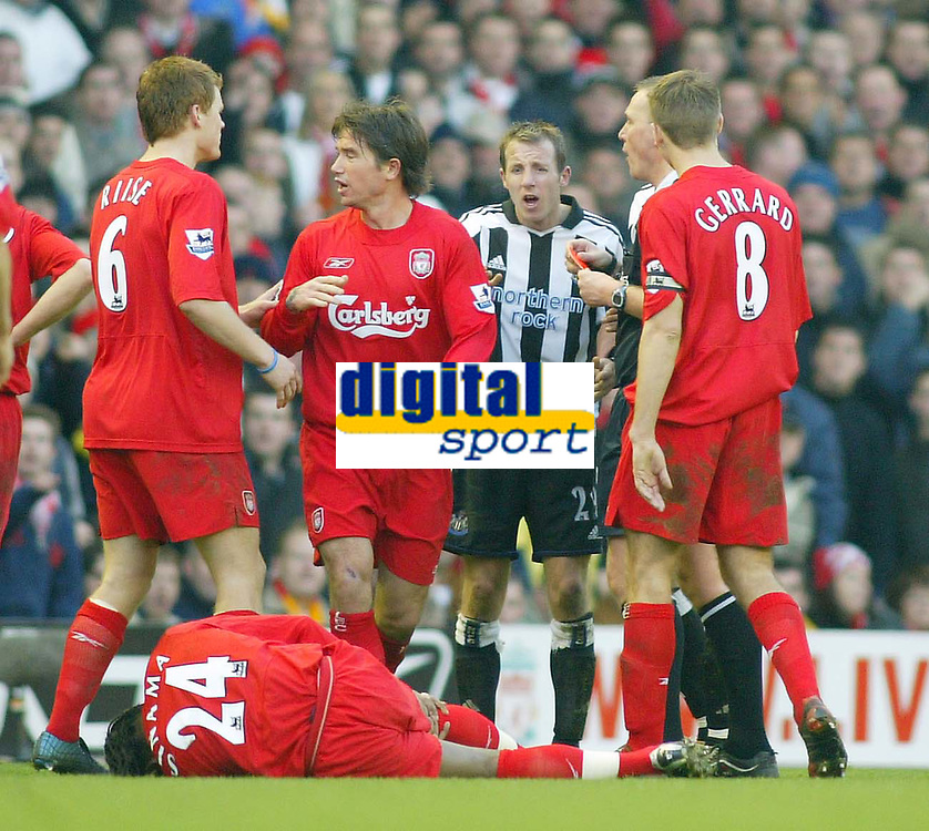 19/12/2004 - FA Barclays Premiership - Liverpool v Newcastle United - Anfield, Liverpool<br />Newcastle United's Lee Bowyer (centre) is sent off by referee Graham Poll after his rash tackle on Florent Sinama-Pongolle<br />Photo:Jed Leicester/Back Page Images