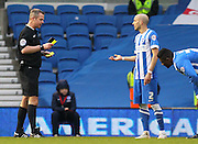 Referee Christopher Sarginson shows the yellow card to Brighton's Bruno Saltor during the Sky Bet Championship match between Brighton and Hove Albion and Nottingham Forest at the American Express Community Stadium, Brighton and Hove, England on 7 February 2015. Photo by Phil Duncan.