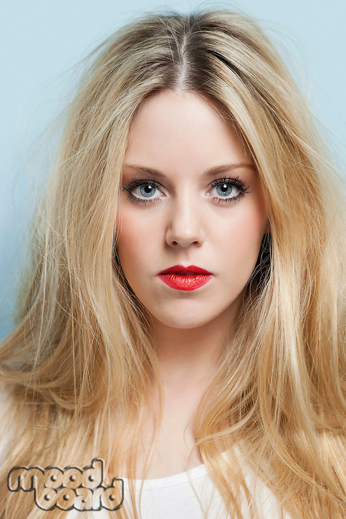 Close-up portrait of beautiful young woman with blond hair and red lips