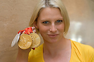 Leisel JONES of Australia poses for the photographer with all her medals at the main press center at the Beijing 2008 Olympic Games in Beijing, China, Monday, Aug. 18, 2008. (Photo by Patrick B. Kraemer / MAGICPBK)