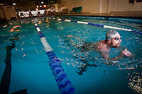 JEROME A. POLLOS/Press..Dennis Desmarais rises out of the water as he prepares to turn and complete another lap in the pool Wednesday at Peak Fitness in Coeur d'Alene. The Hayden Lake resident comes to the fitness center twice a week to swim two miles in the pool.