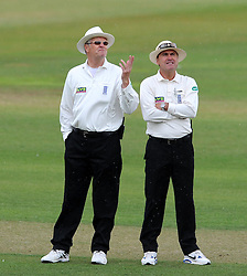 Umpire's Steven Garratt and Steven O'Shaughnessy look to the skies at rain forces an early lunch. - Photo mandatory by-line: Harry Trump/JMP - Mobile: 07966 386802 - 05/07/15 - SPORT - CRICKET - LVCC - County Championship Division One - Somerset v Sussex- The County Ground, Taunton, England.