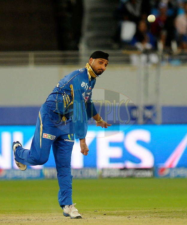 Harbhajan Singh of the Mumbai Indians bowls during match 20 of the Pepsi Indian Premier League Season 2014 between the Mumbai Indians and the Sunrisers Hyderabad held at the Dubai International Stadium, Dubai, United Arab Emirates on the 30th April 2014<br /> <br /> Photo by Pal Pillia / IPL / SPORTZPICS