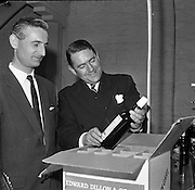 26/09/1962<br /> 09/26/1962<br /> 26 September 1962<br /> Opening of Earl Bottlers Ltd. at South Earl Street, Dublin. Minister for Justice Charles Haughey opened the new premises that produced Sandyman port. Picture shows Mr Anthony Dillon (right) Director of Earl Bottlers, showing bottles destined for Edward Dillon and Co., to Mr J.W. Good, (Cork), Director of Gouldings Ltd., Dublin.