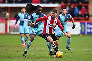 Lee Holmes (10) of Exeter City shields the ball from Marcus Bean (8) of Wycombe Wanderers during the EFL Sky Bet League 2 match between Exeter City and Wycombe Wanderers at St James' Park, Exeter, England on 10 February 2018. Picture by Graham Hunt.