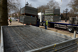 © Licensed to London News Pictures. 18/04/2013. London, UK. Barriers are being placed at The Mall, the location for the London Marathon finish line, on April 18, 2013 in London. The London Marathon will be held on Sunday April 21. Photo credit : Peter Kollanyi/LNP