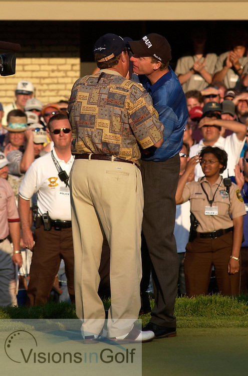 June 2003, US Open, Olympia Fields Country Club, Chicago. Jim Furyk is congratulated by his father on the 18th green after his first major win.<br />