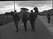 Army Exercises In Co Sligo.   (L37).<br /> 1977.<br /> 05.09.1977.<br /> 09.05.1977.<br /> 5th September 1977.<br /> The Army Reserve Brigade, which is made up of regular units from the Southern Command, are conducting a series of conventional military exercises in counties Mayo and Sligo from the 5th to the 9th September. Approximately 1,500 men and 250 vehicles are involved. The exercise was codenamed &quot;Humbert&quot; after an ill fated expedition by French troops into Ireland on 23rd August 1798. 1,100 French troops with Irish support took on the incumbent English forces. After some initial success they were defeated at Ballinamuk on 8th Sept 1798 by the army of Cornwallis.<br /> <br /> Picture shows some soldiers taking up position during the military exercises.
