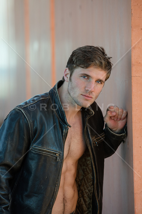 Hot man in a leather jacket and no shirt