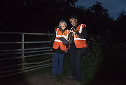 © Licensed to London News Pictures. 31/08/2016. Newent, Gloucestershire, UK. Badger Cull 2016. Members of the Wounded Badger Patrol from Gloucester Against Badger Shooting (GABS) patrol within the cull zone looking for any wounded badgers. The Wounded Badger Patrol aims to get help for badgers which have been shot and wounded but not killed, and are in attendance to help suffering animals which need veterinary help and not to disrupt the cull. The 2016 badger cull began this week, with the Government announcing the cull would be rolled out to new zones in Herefordshire, North Cotswolds, West Dorset, Devon and North Cornwall, effectively tripling the previous culling areas. The Government has licensed the culling of badgers by shooting to try and stop the spread of bovine tuberculosis, but campaigners and some scientists dispute the Government and farming industry view of bovine TB transmission from badgers to cows, and the efficacy and humaneness of shooting badgers to prevent the spread of TB in cattle.  Photo credit : Simon Chapman/LNP