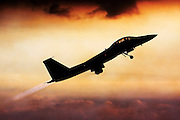 Silhouette of an Israeli Air force F-15I Fighter in flight at sunset